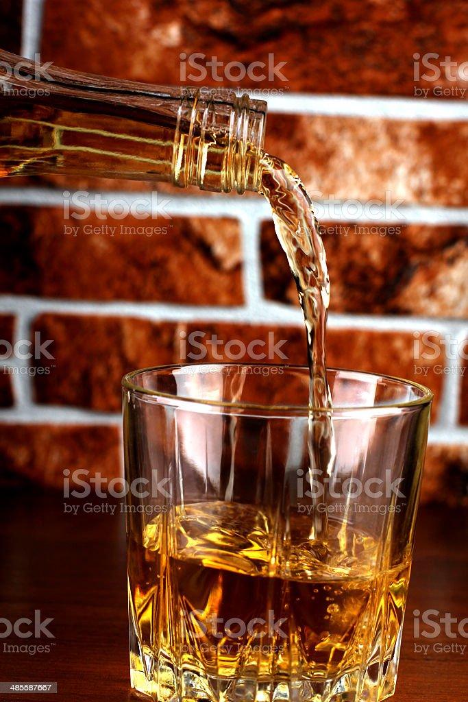 Whiskey glass on brick stock photo