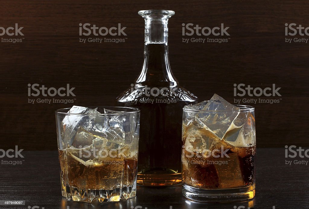 Whiskey glass on darck stock photo