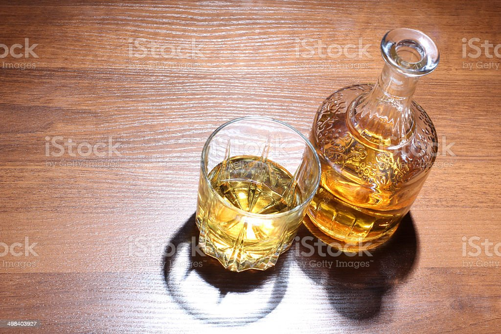 Whiskey glass on table stock photo