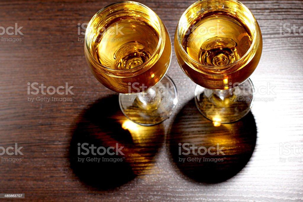 Whiskey glass on wood stock photo