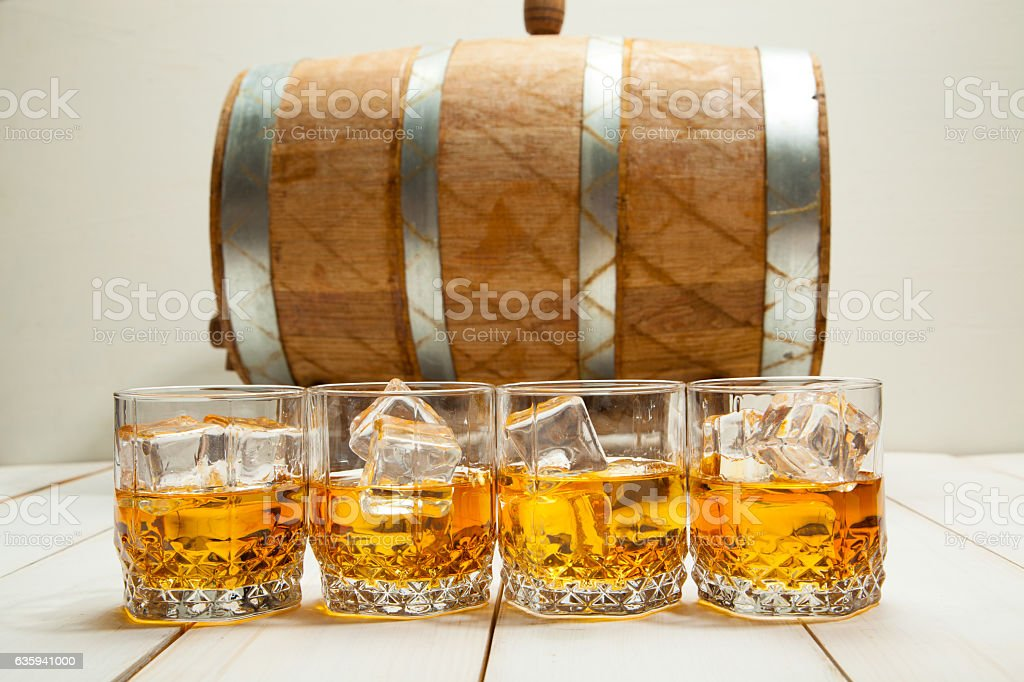 whiskey glass with ice and a carafe on the background stock photo