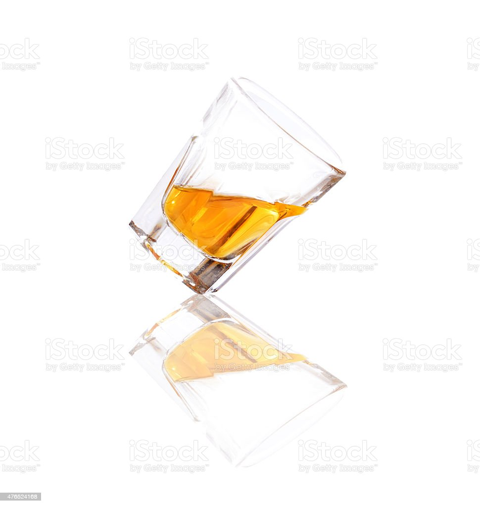 Whiskey in a shot glass isolated on a white background stock photo