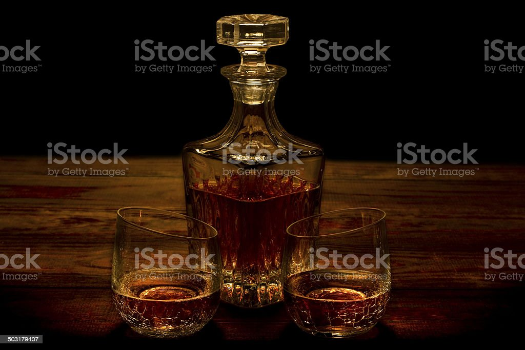 Whiskey in Cracked Glasses with Decanter stock photo