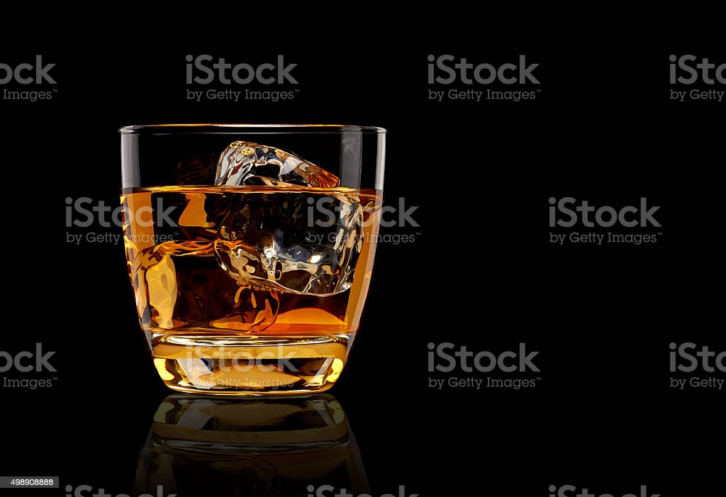 Whiskey in glass stock photo
