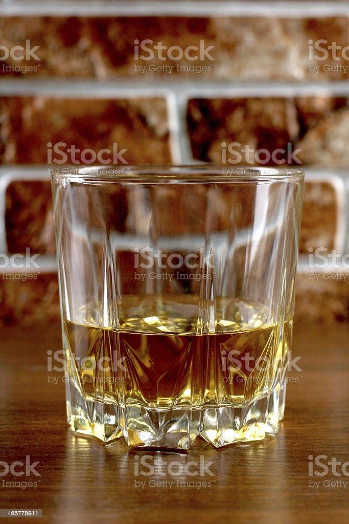 Whiskey on brick stock photo