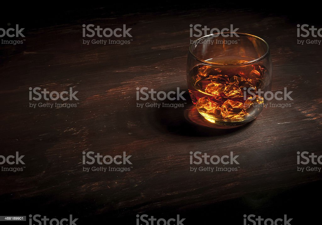 Whiskey on Dark Wood Bar stock photo