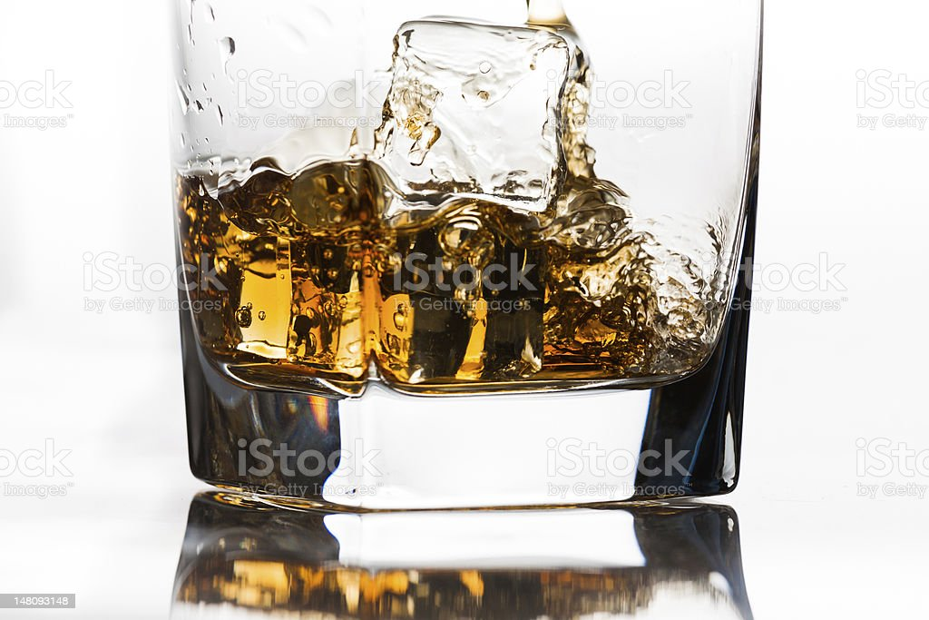 Whiskey on the rocks being poured royalty-free stock photo