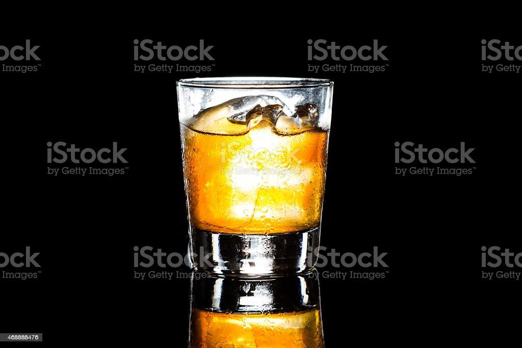 Whiskey on the rocks dark background stock photo