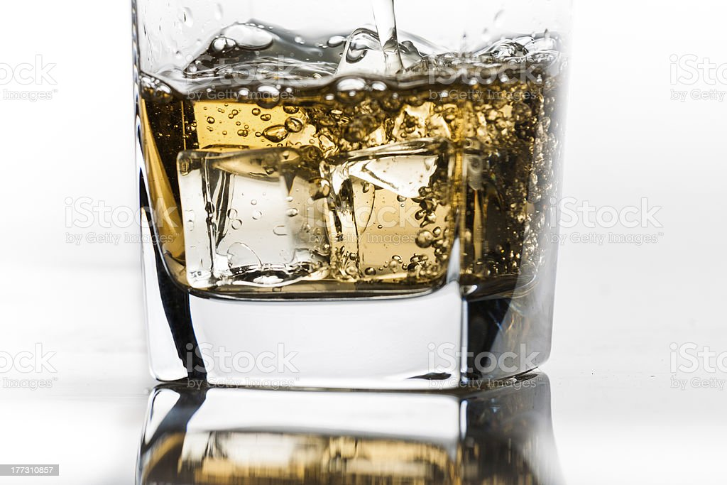 Whiskey on the rocks filling up royalty-free stock photo