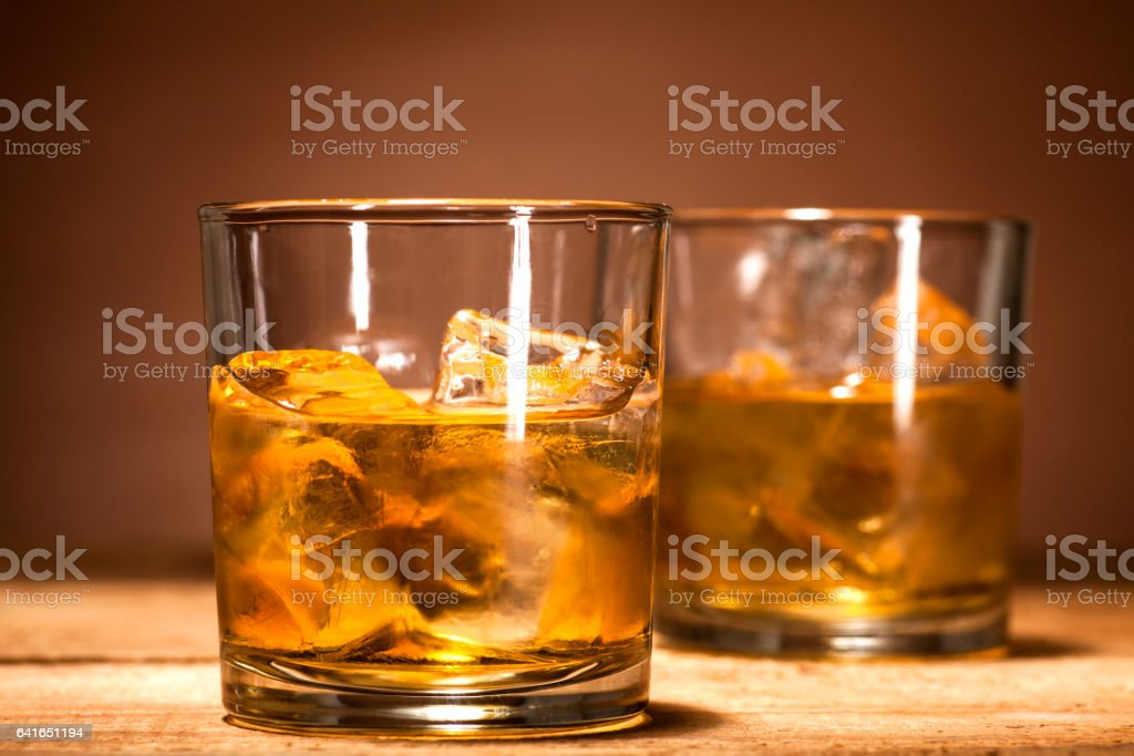 Whiskey on wooden background stock photo