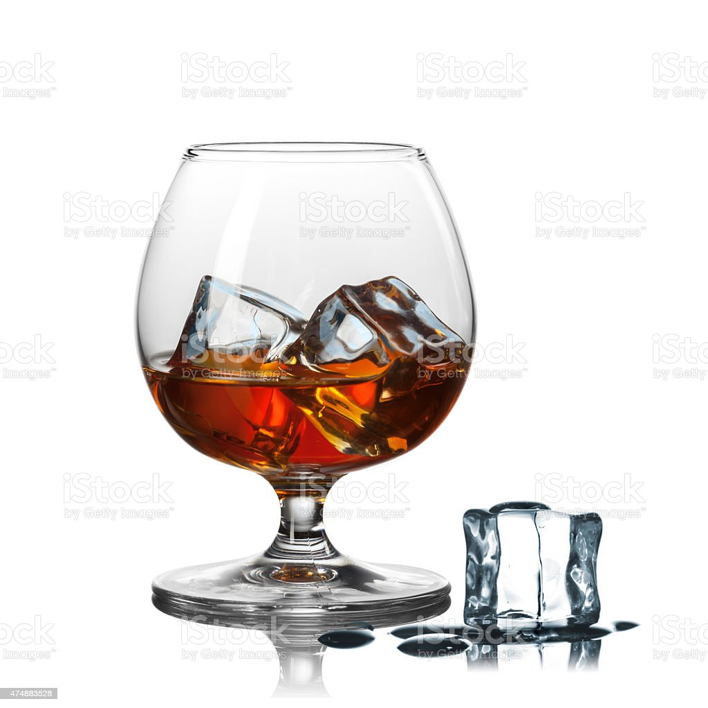 whiskey with ice in glass isolated on white background stock photo
