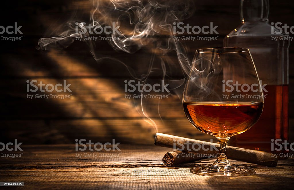 Whiskey with smoking cigar stock photo