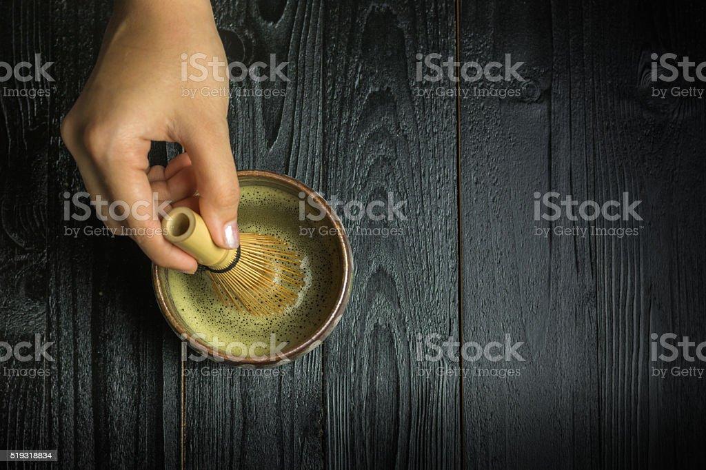 Whisking matcha powder by a chasen royalty-free stock photo