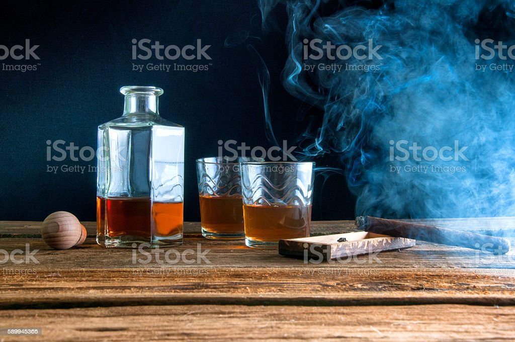 Whisky and cigar on wooden table stock photo