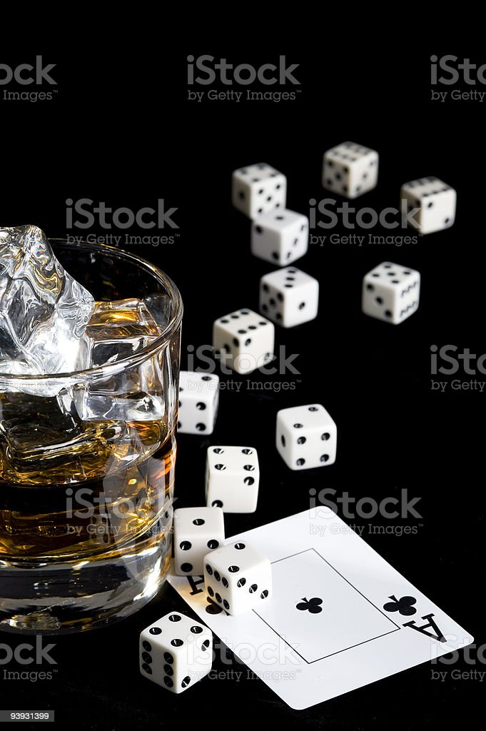 Whisky and playing card stock photo