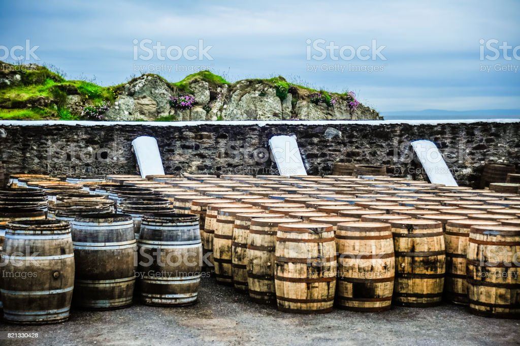 Whisky barrels by the sea stock photo