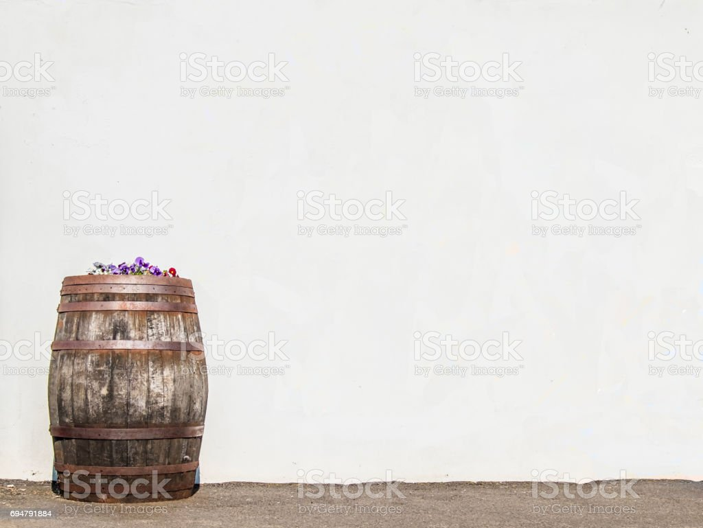 Whisky cask in front of wall stock photo