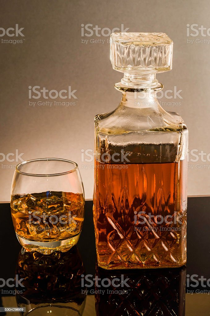 whisky decanter with glass and ice cubes colour image stock photo