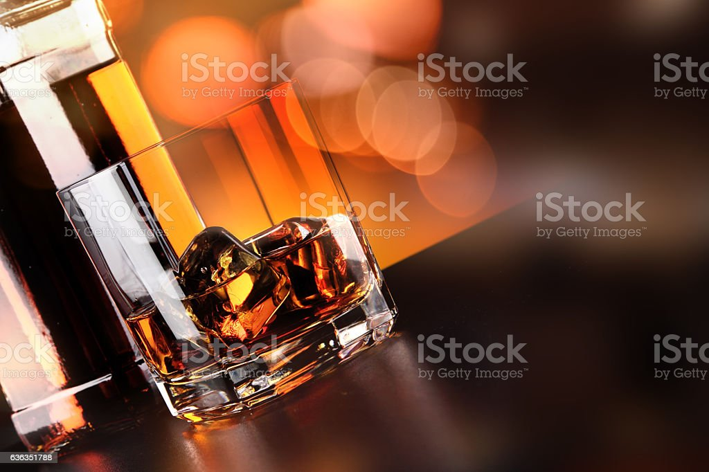 Whisky glass and bottle on the bar stock photo