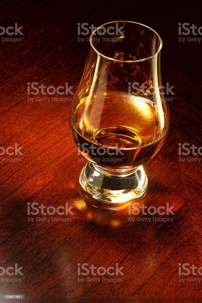Whisky in a Glencairn glass. stock photo
