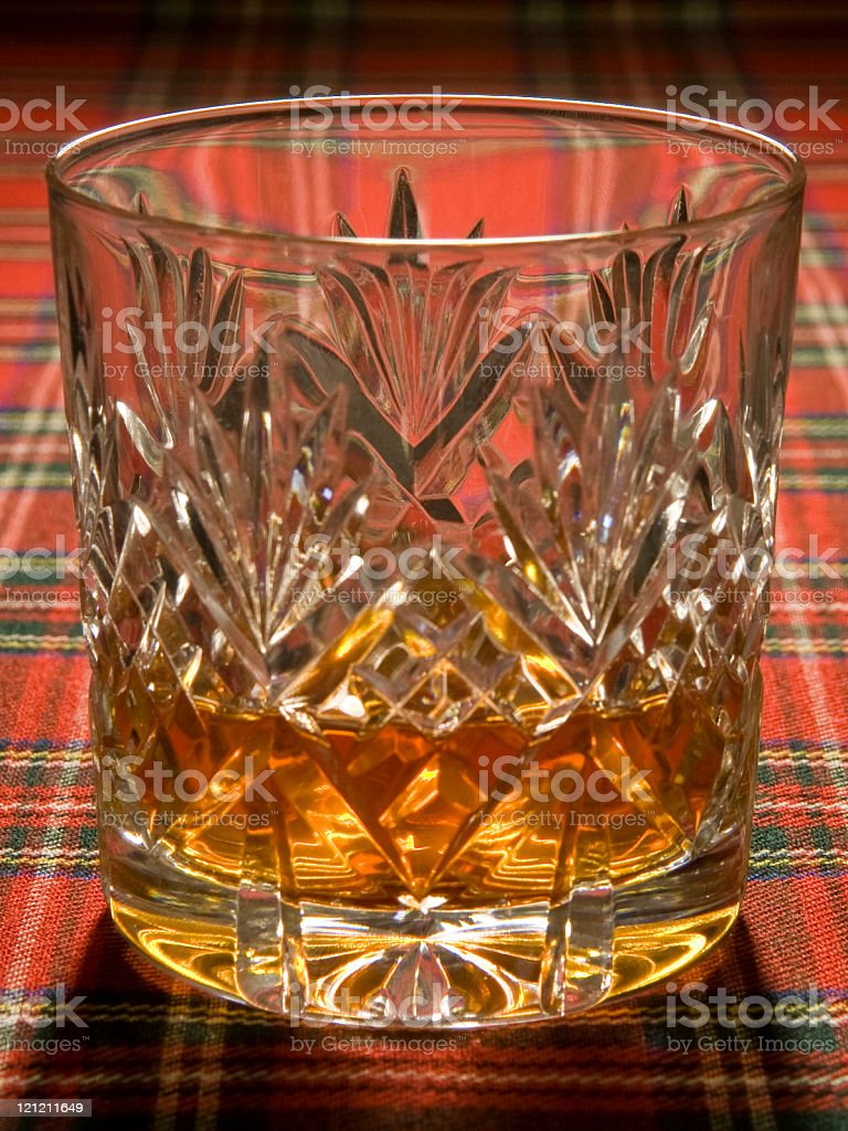 Whisky in Crystal Glass on Tartan royalty-free stock photo
