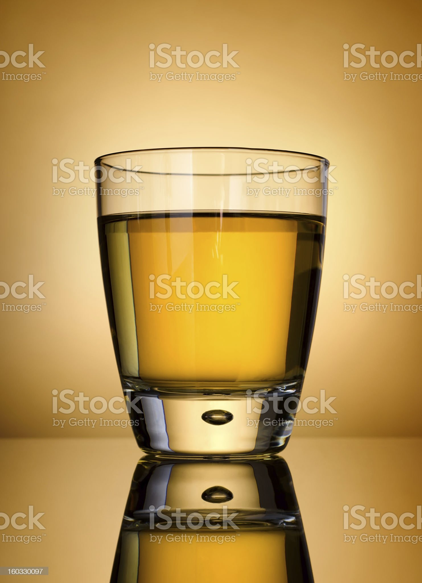 Whisky on a gold background royalty-free stock photo