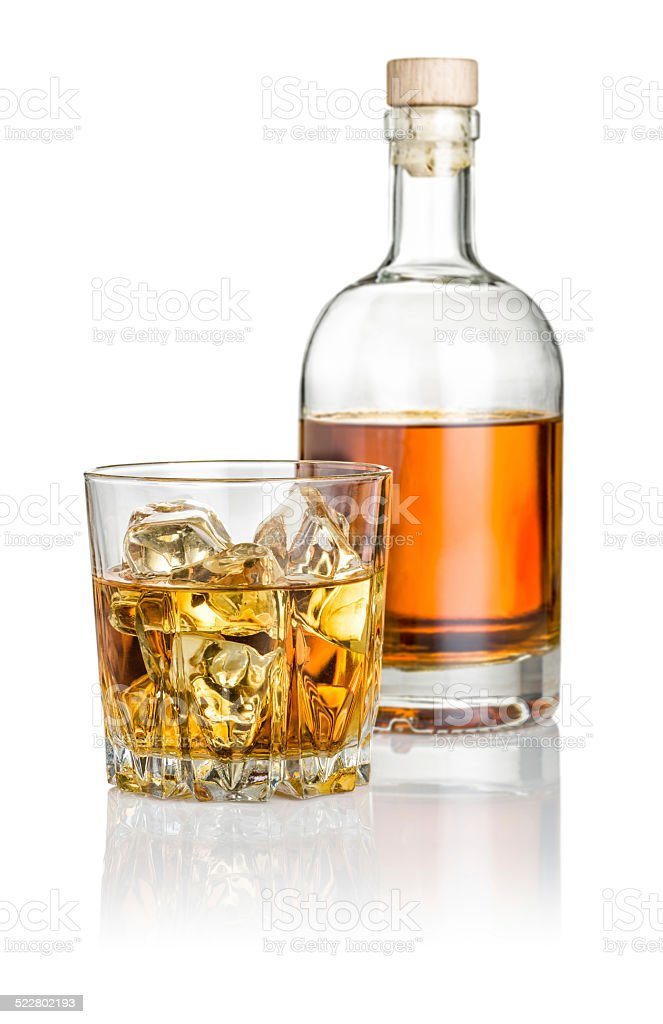 Whisky on the rocks with a bottle stock photo