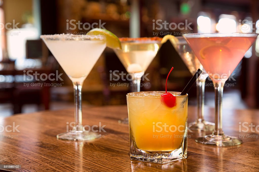 Whisky Sour and a Variety of Martinis stock photo
