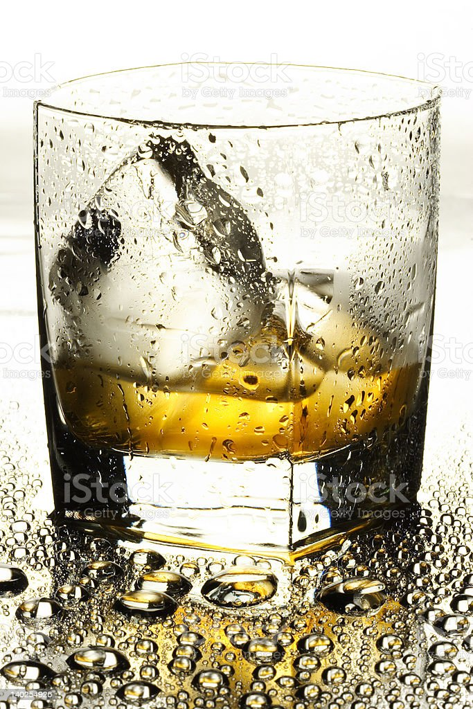 Whisky with an ice royalty-free stock photo