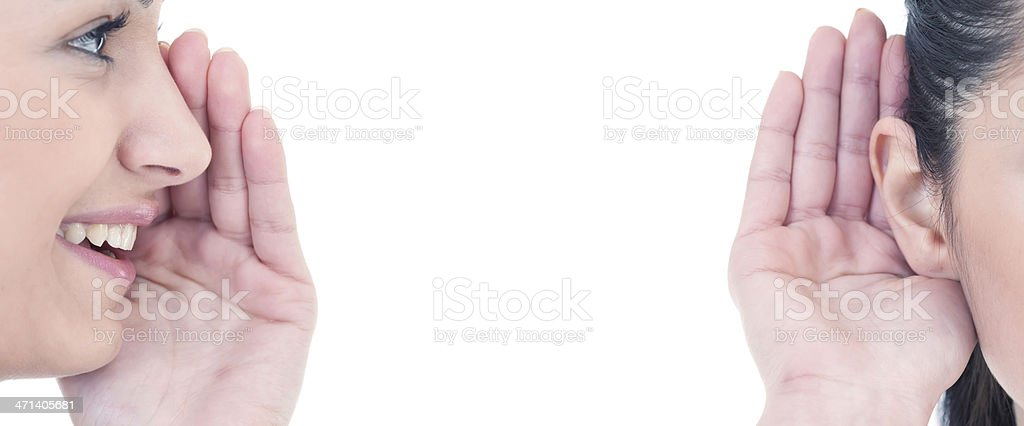 Whispering into her ear stock photo