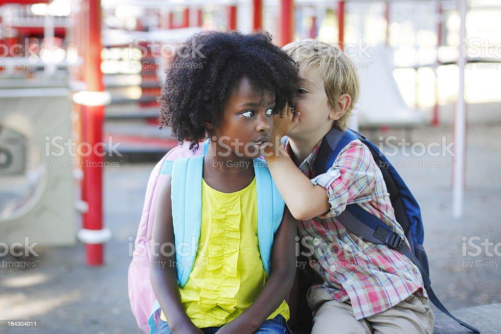 Whispering School Children stock photo