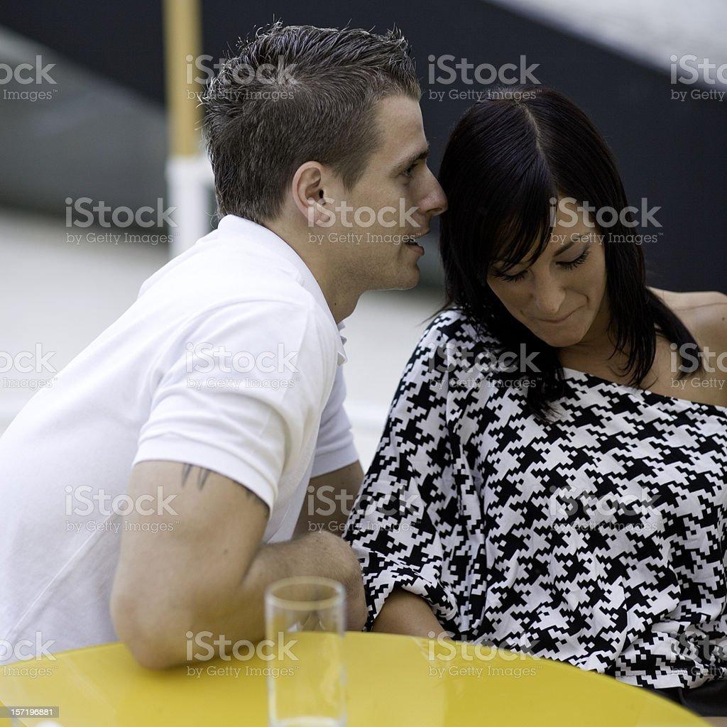 whispering secrets stock photo