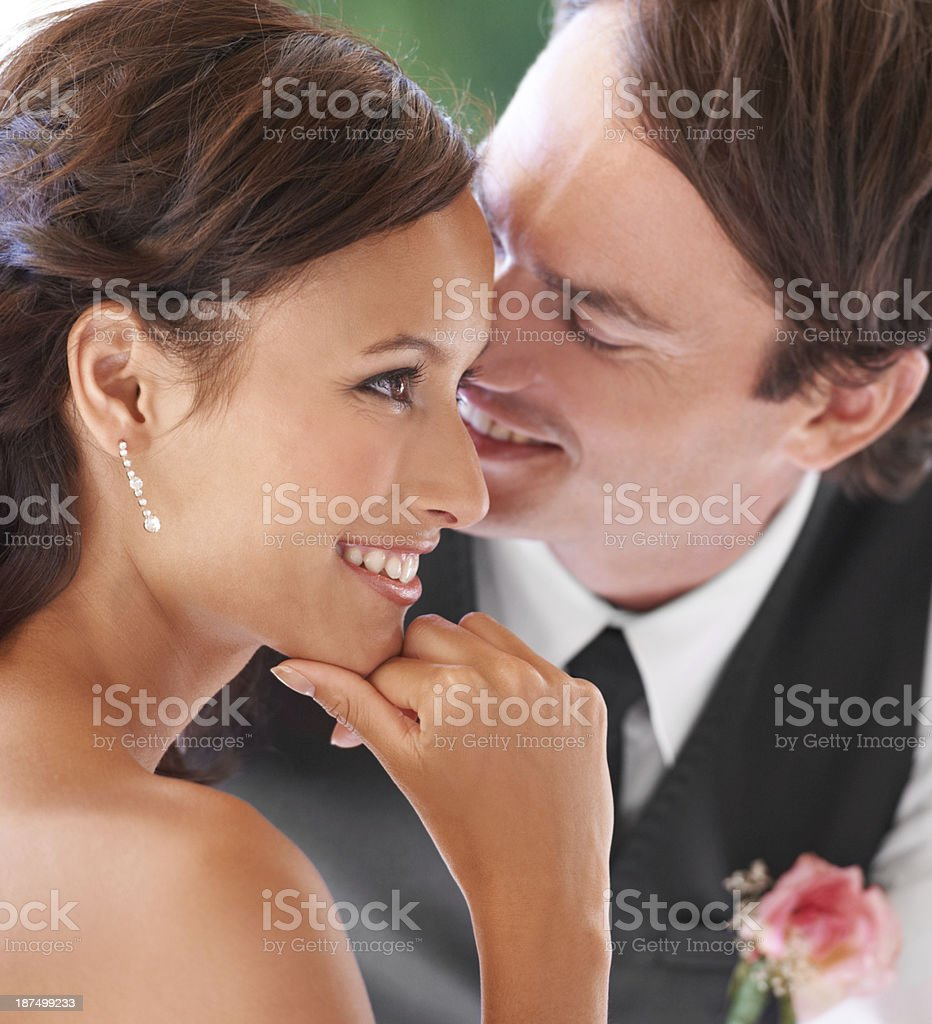 Whispering sweet nothings to his lovely bride stock photo