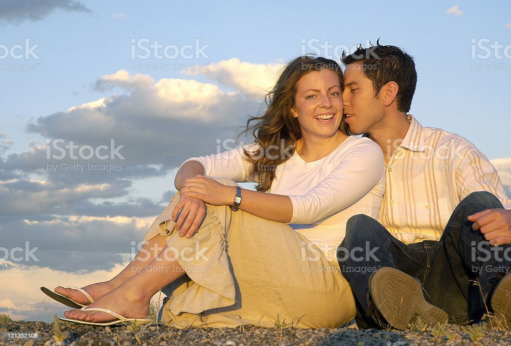 Whispering that he loves her royalty-free stock photo