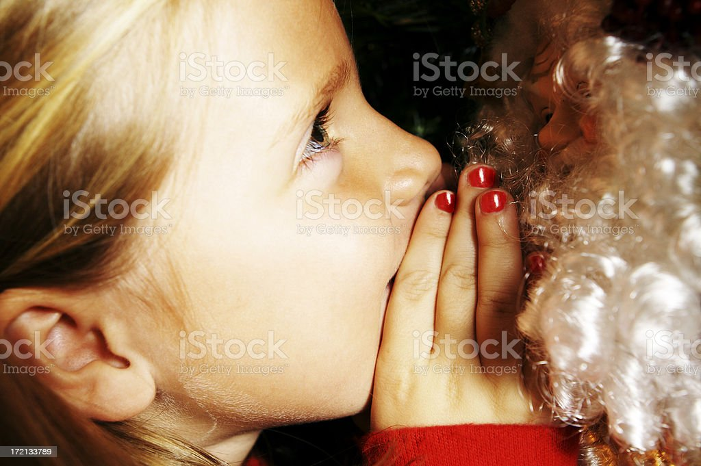 Whispering to Santa royalty-free stock photo