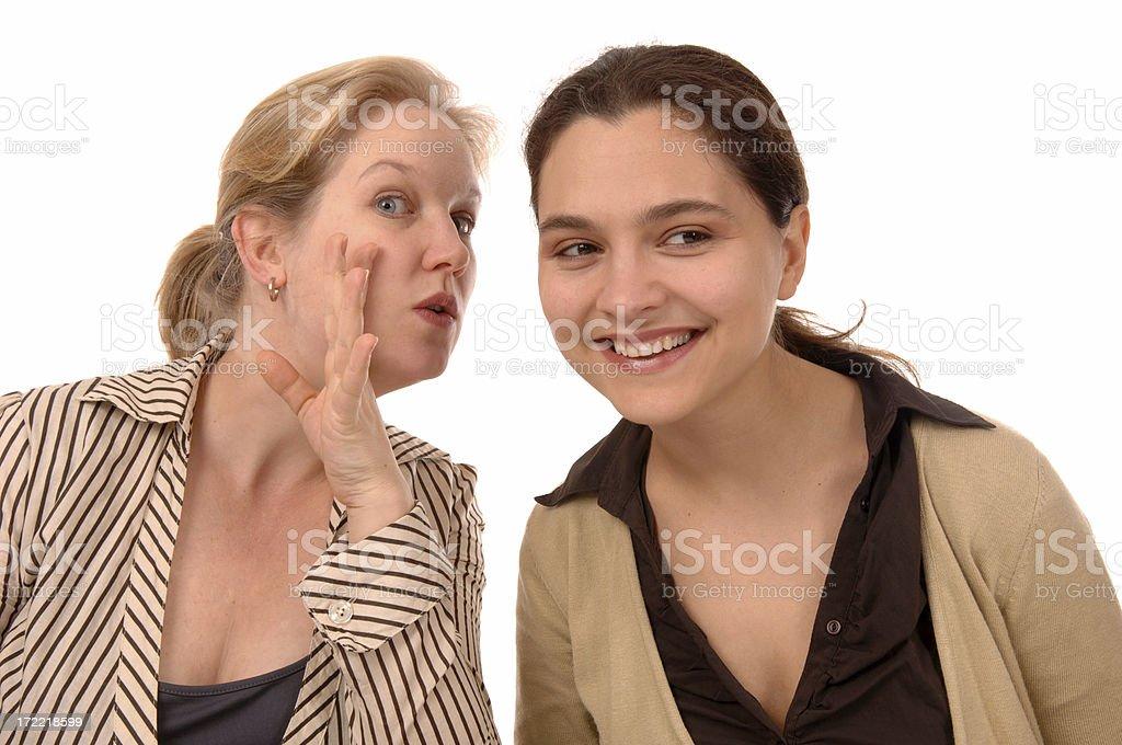 whispering women stock photo