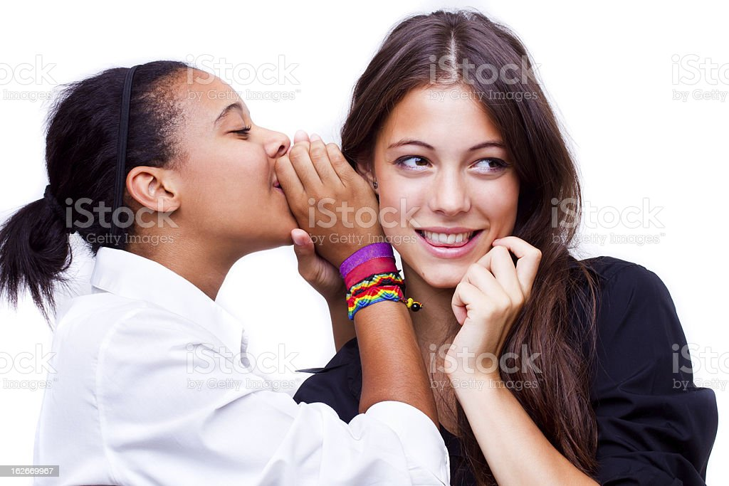 whispers into her ear stock photo