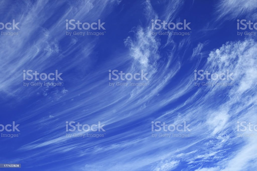 Whispy long clouds in the blue sky stock photo
