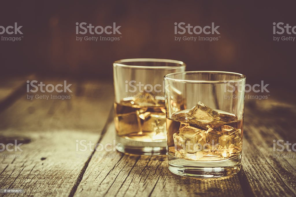 Whistey with ice in glasses stock photo
