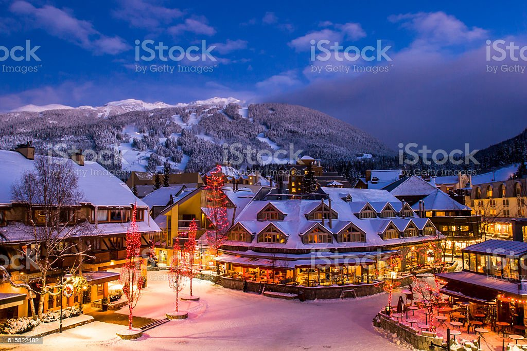 Whistler winter village at dusk. stock photo