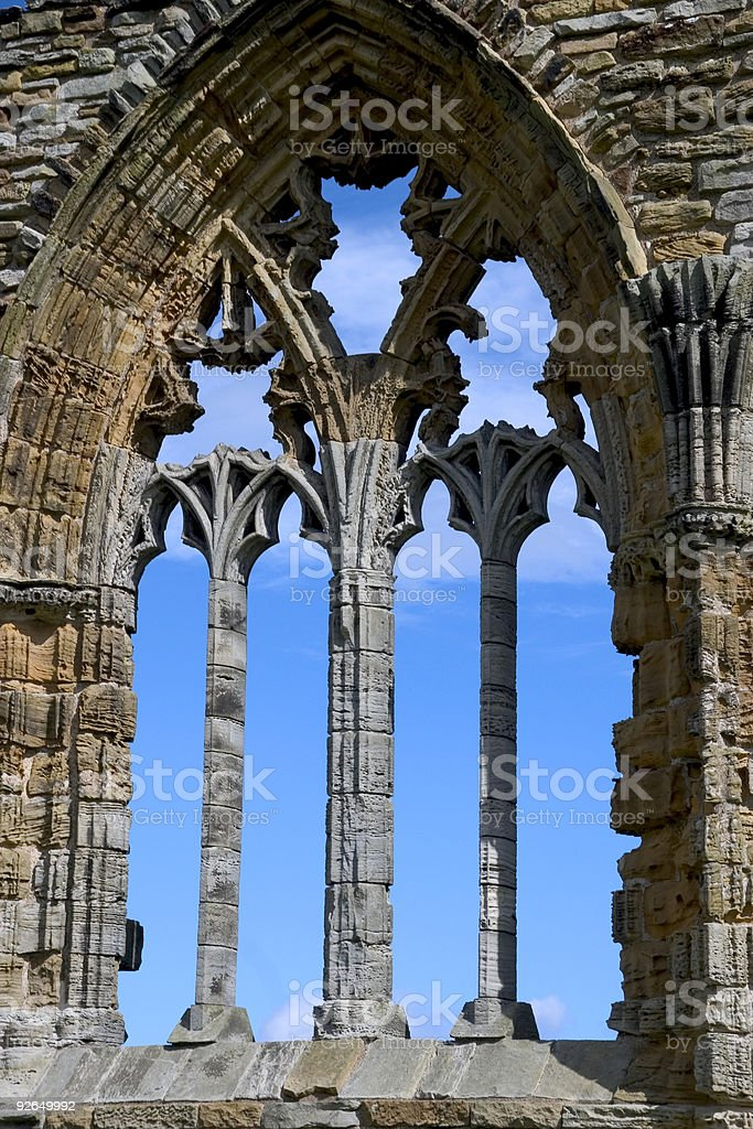 Whitby Abbey window against sky stock photo