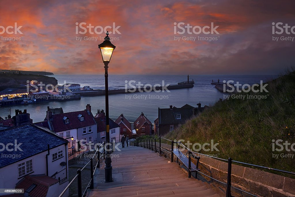 Whitby at dusk - 199 steps leading down from Abbey stock photo