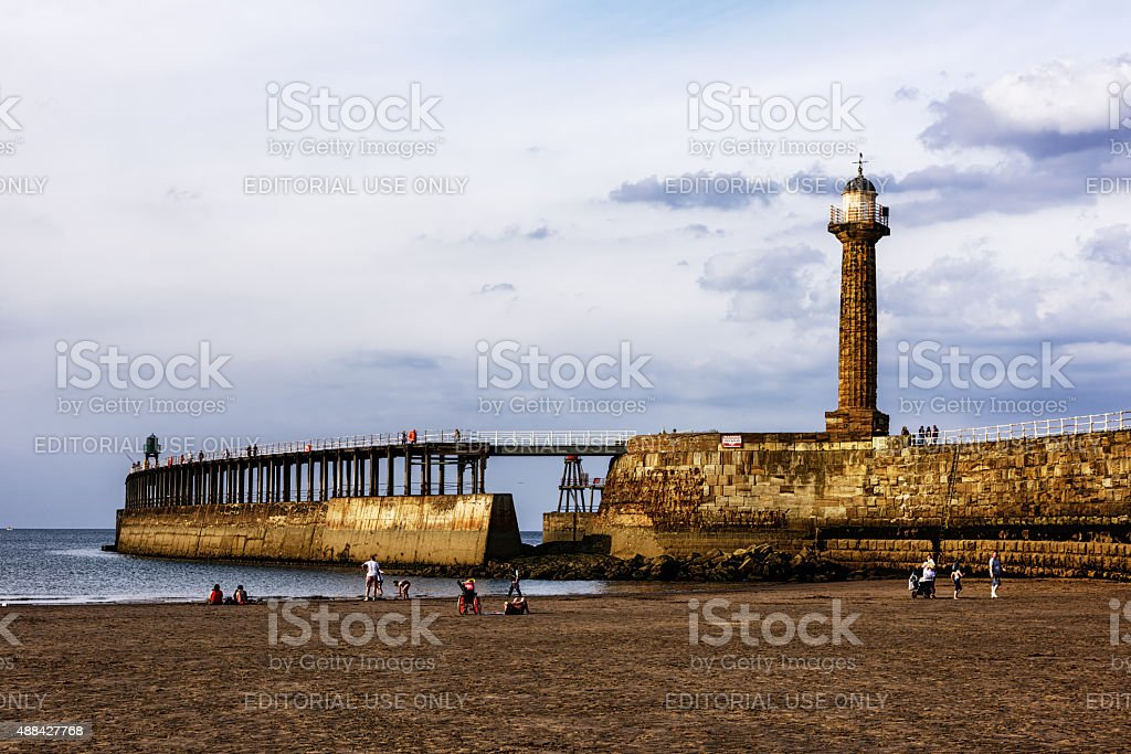 Whitby harbour lighthouse and beach,  North Yorkshire stock photo