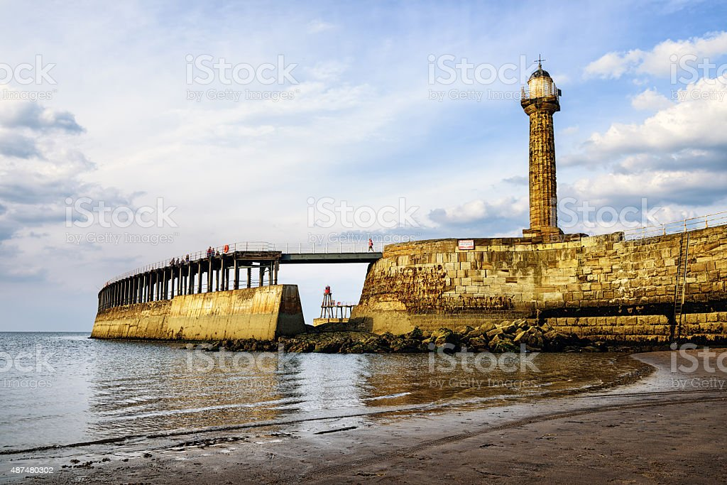 Whitby harbour lighthouse in North Yorkshire stock photo