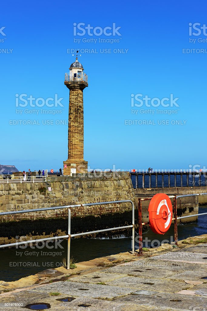 Whitby harbour lighthouse stock photo