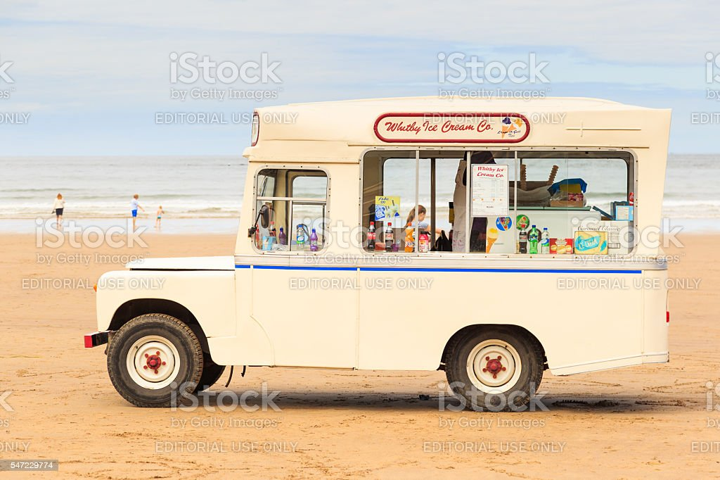 'Whitby Ice Cream Co' ice cream van on beach, Whitby stock photo
