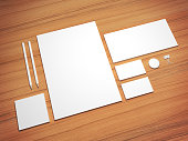 White 3d illustration mock up on wooden background with button.