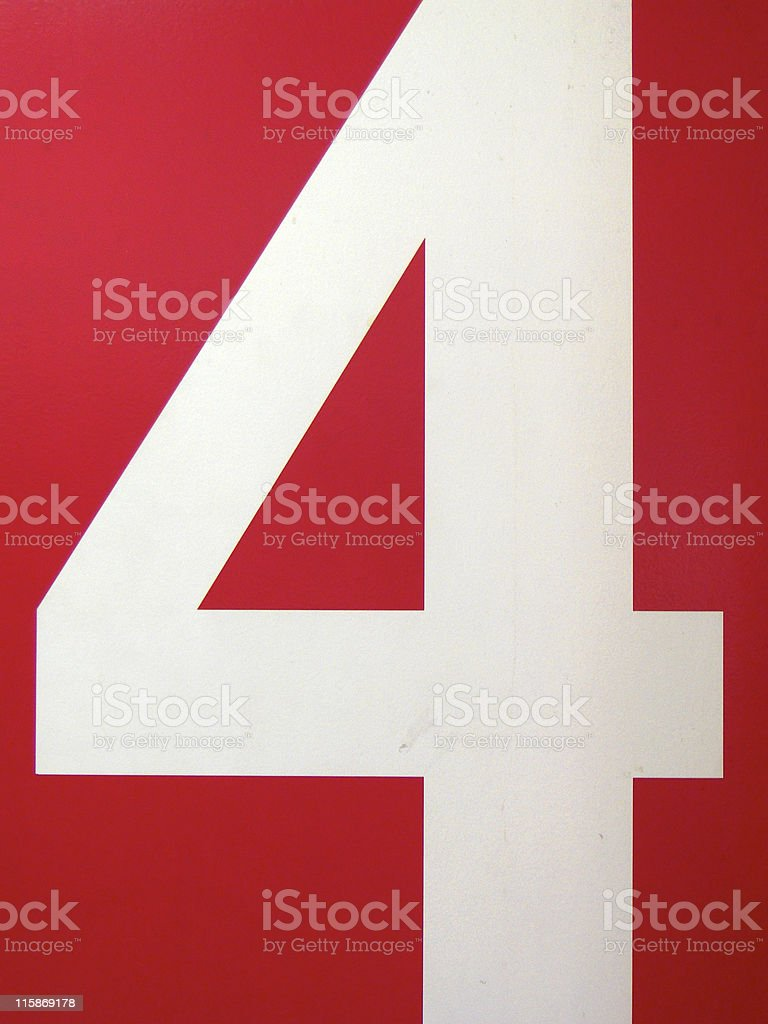 White '4' on a Red Wall stock photo