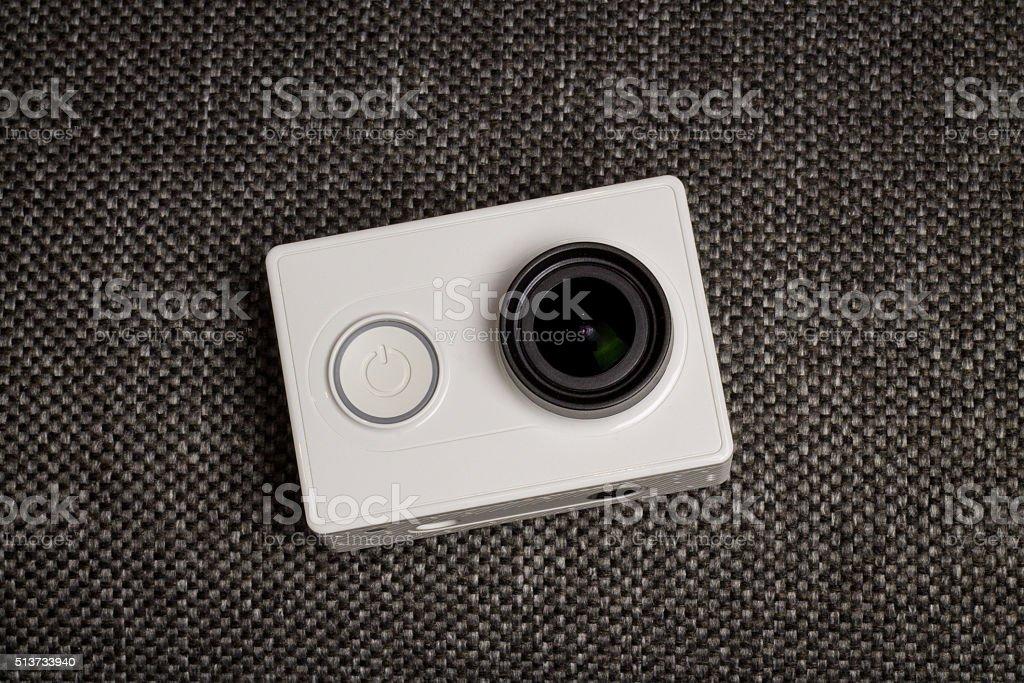 White Action Camera. Minimal stock photo