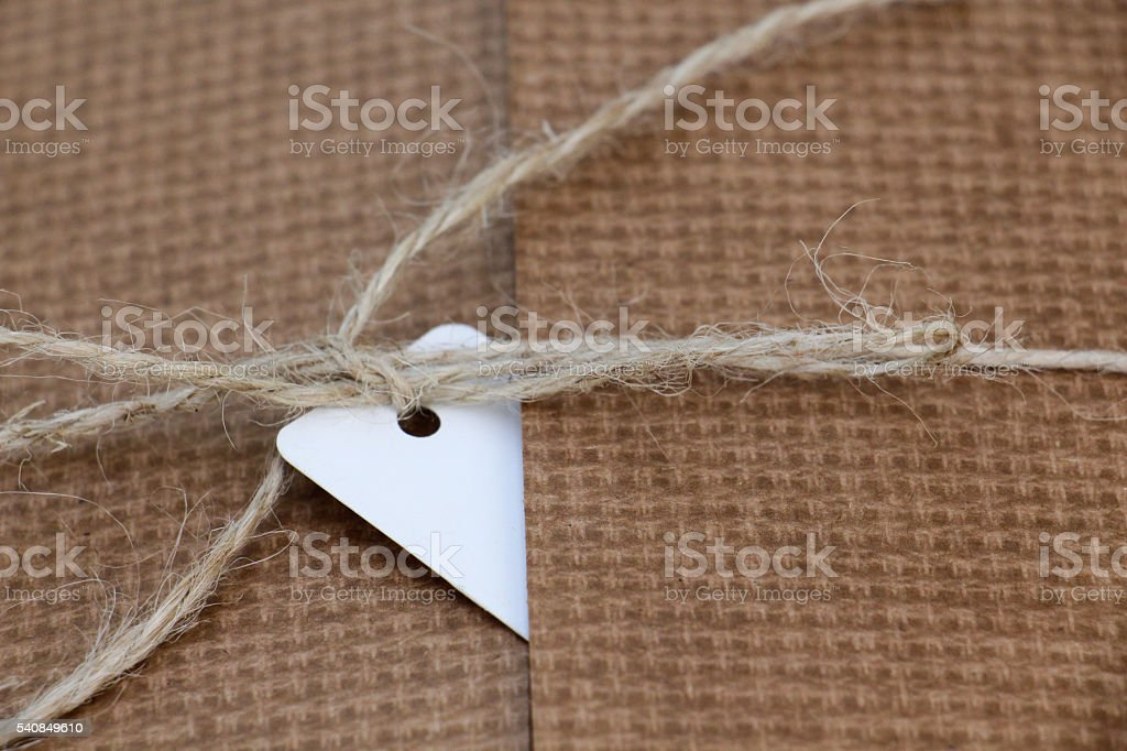 white address label on a brown carboard, close up stock photo